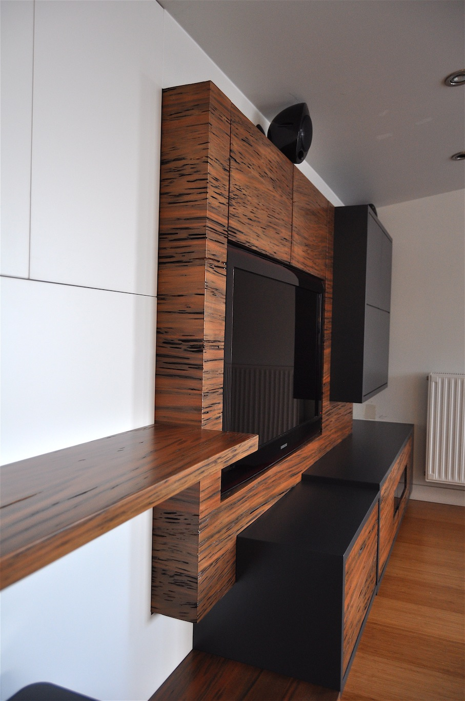 Living room entertainment unit with reclaimed Totara
